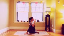 Woman in a seated twist on a yoga mat