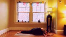 Woman in sleeping pigeon variation (yoga pose)
