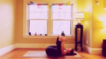 Woman in happy baby (yoga pose)