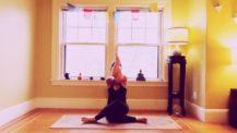 Woman in gomukhasana (shoelace in yin) yoga pose