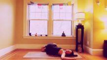 Woman in supine twist (yoga pose)