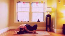 Woman in revolved side bend variation (yoga pose)