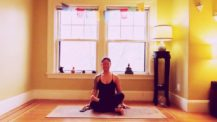 Woman in double pigeon (fire log/agnistambasana) yoga pose