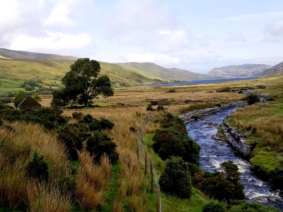 River running through landscape of Connemara National Park