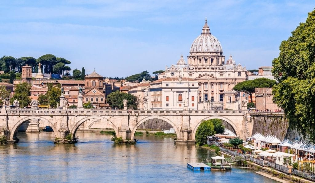 Ponte Umberto I in Rome with the Tiber River and Roman buildings.