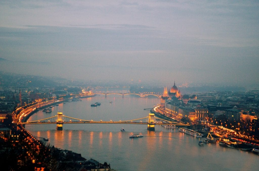 Fog covering Budapest, showing Chain Bridge and Parliament as well as the Buda side of the river lit in golden light.
