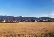 Fields, houses, with the Austrian alps in the background of the overnight train from Rome to Vienna