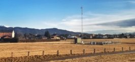 Panoramic view of fields and the alps on the overnight train from Rome to Vienna
