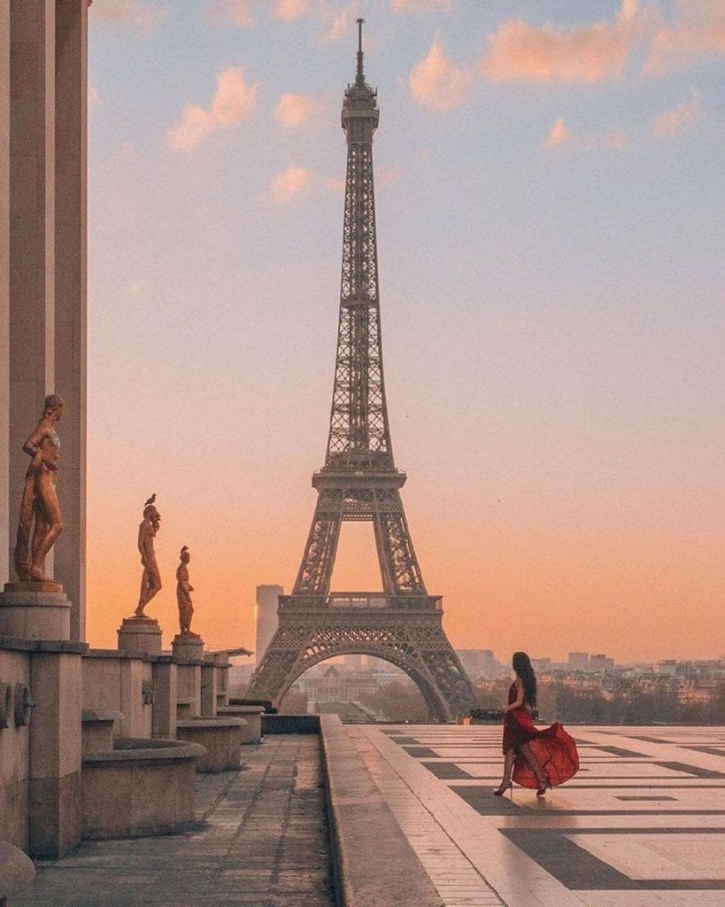 Woman in flowing dress at Trocadero in front of Eiffel Tower