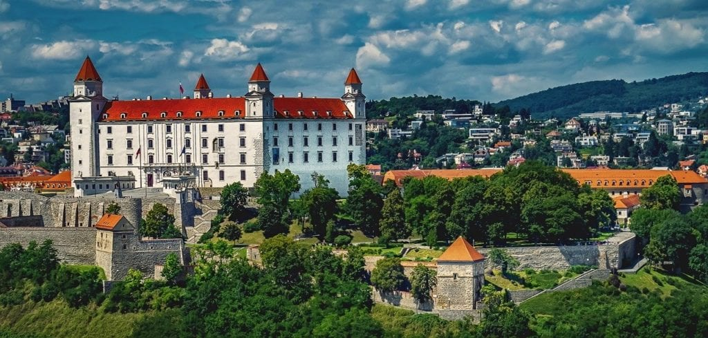 Bratislava Castle with its white façade and red roofs seen from a distance