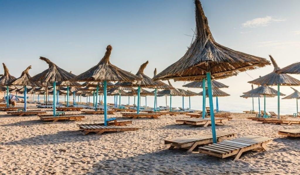 Beach chairs and natural fiber umbrellas at Vama Veche, Romania.