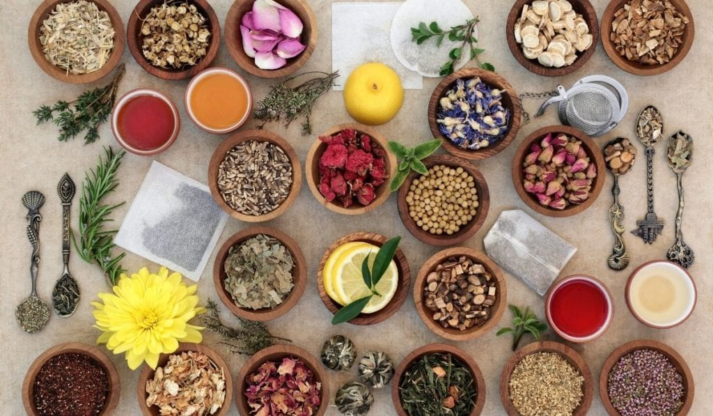 Small jars of different spices, berries, and other herbal remedies for ayurvedic purposes.