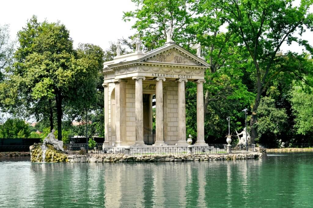 Circular domed temple surrounded by water at Villa Borghese, Rome, Italy.