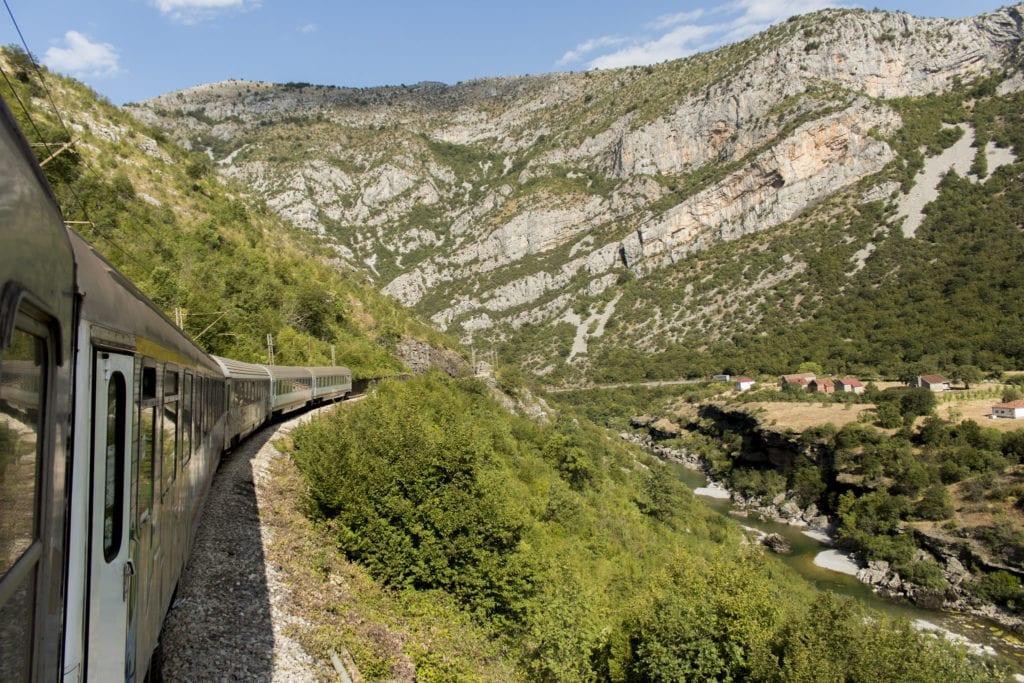 Train winding through mountains heading from Belgrade, Serbia to Bar, Montenegro.