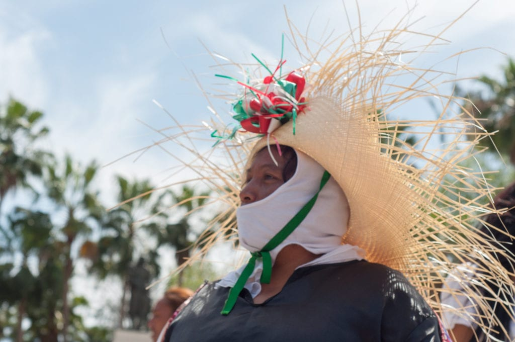 Mexican woman in woven hat during Cinco de Mayo, a spring festival mainly celebrated in Pueblo, Mexico.