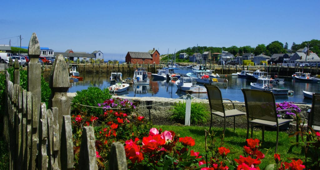 Well-manicured lawn overlooking the Rockport Harbor, a great day trip from Boston.
