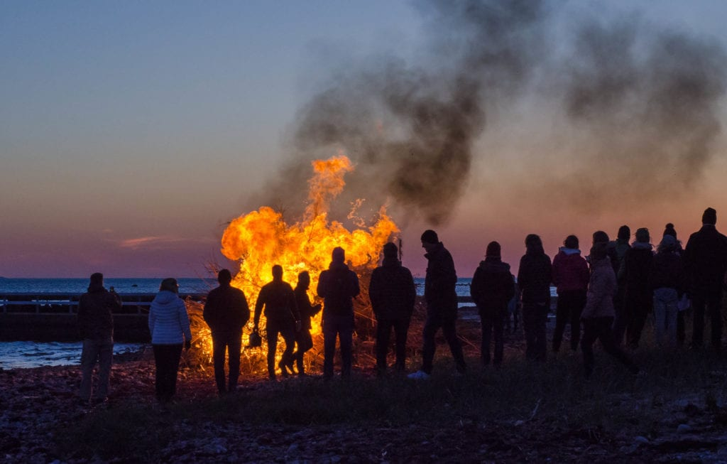 Walpurgis Night, a spring celebration from Sweden with a large bonfire and people fathered around at dusk.