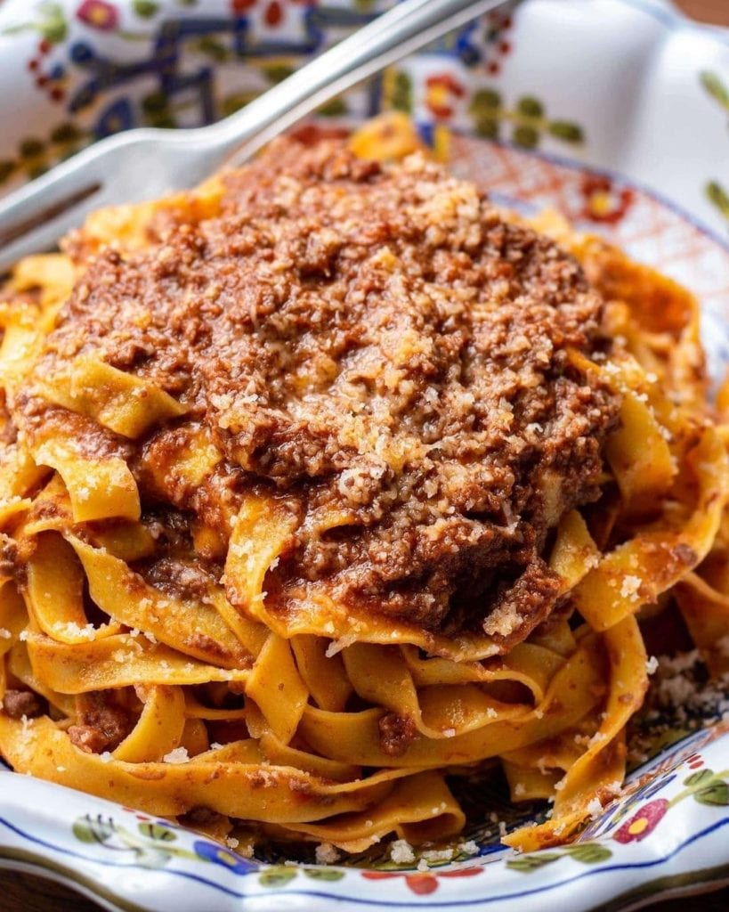 Heaping plate of tagliatelle with a meat ragu, sometimes referred to as Bolognese sauce.