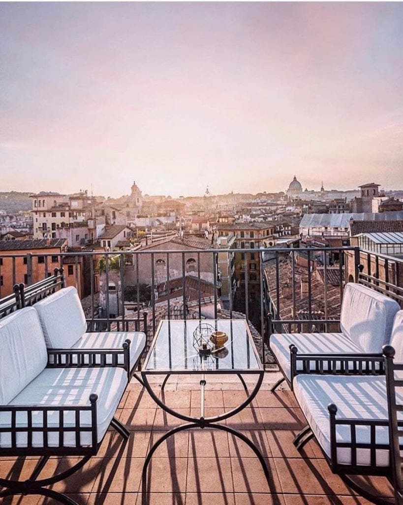 Rooftop terrace of Eitch Borromini overlooking the city of Rome, one of the most Instagrammable places in Rome.