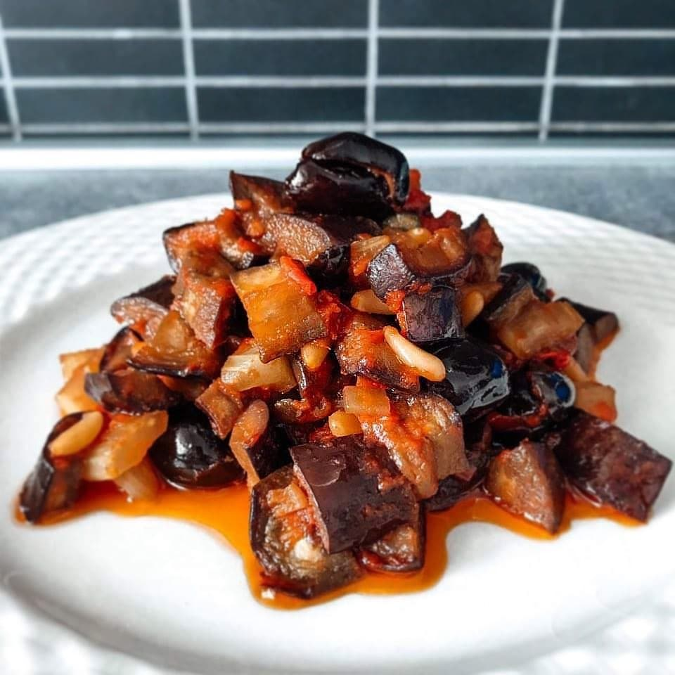 A heaping pile of eggplant caponata, a traditional Sicilian dish to try.