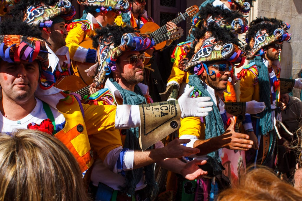 Carnival de Cadiz in Cadiz, Spain with people dressed in colorful traditional clothing during the spring event.