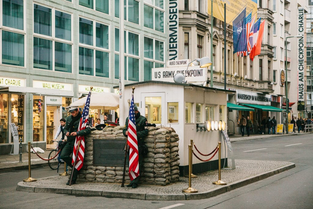Checkpoint Charlie with two American flags out front in Berlin, Germany.