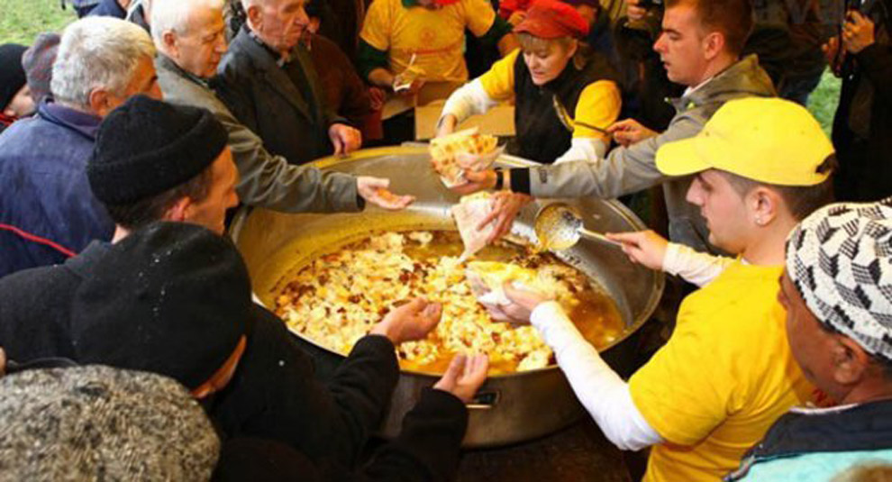People gathered around a large pot of eggs during Bosnia's annual spring Cimburijada festival.