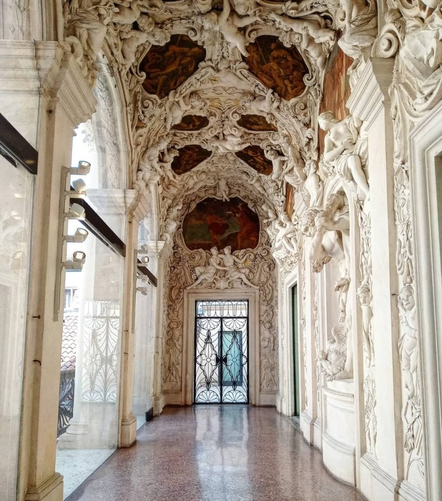 Gallerie di Palazzo Leoni Montanari in Vicenza, Italy with ornate detail down a corridor.