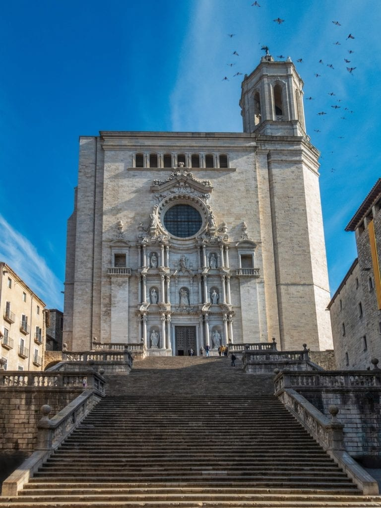 Looking up the steps to a medieval cathedral in Girona, Spain.