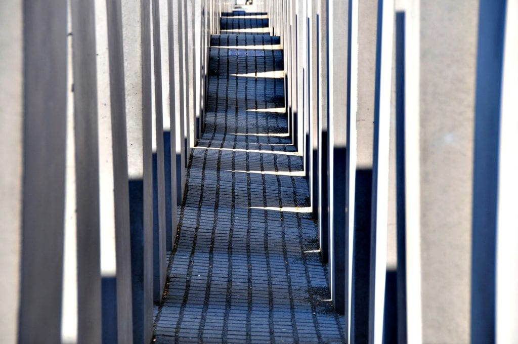Aisle with curved pavement at the Holocaust Memorial in Berlin, Germany.