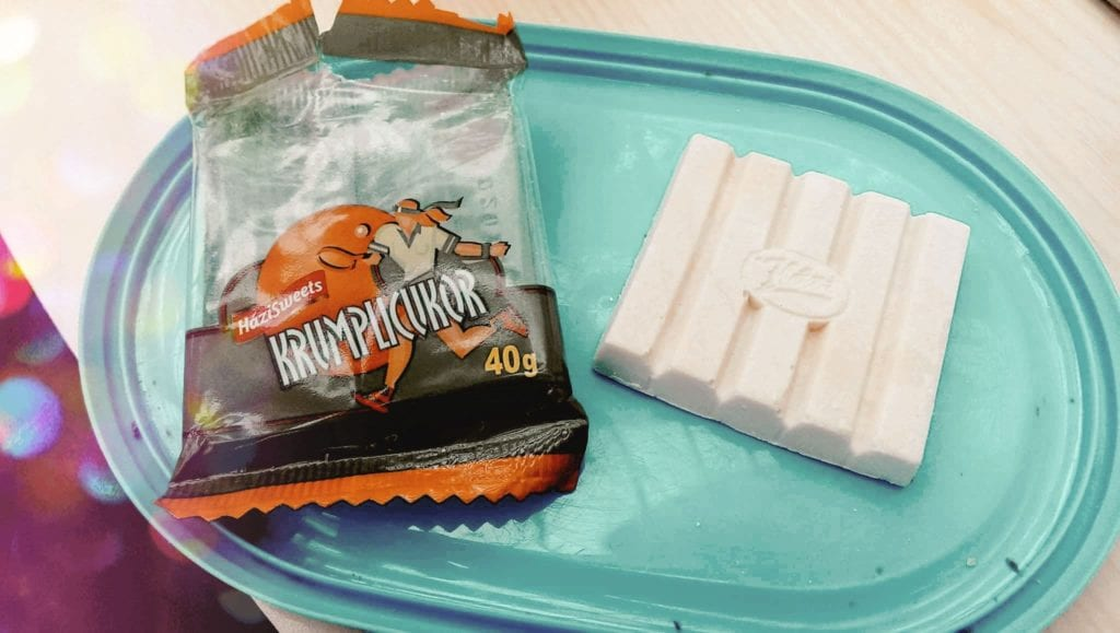 Hungarian potato candy, Krumplicukor, a 'healthier' alternative shown on a turquoise platter next to an empty package.