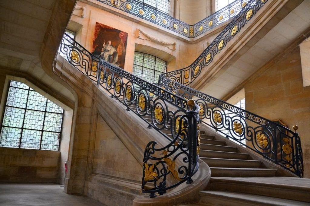 Marble staircase at the entryway of Abbey Saint-Remi, which is now home to a museum, a great thing to do in Reims.