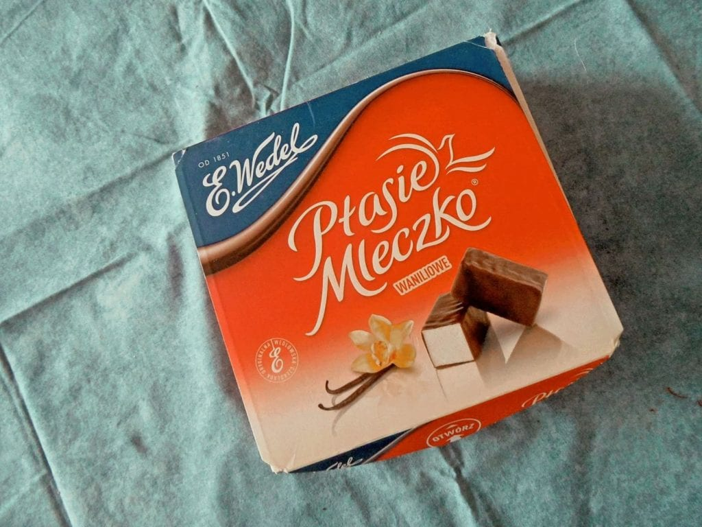 Box of Polish 'bird's milk' candy set upon a teal table cloth, one of the most interesting candies in the world.