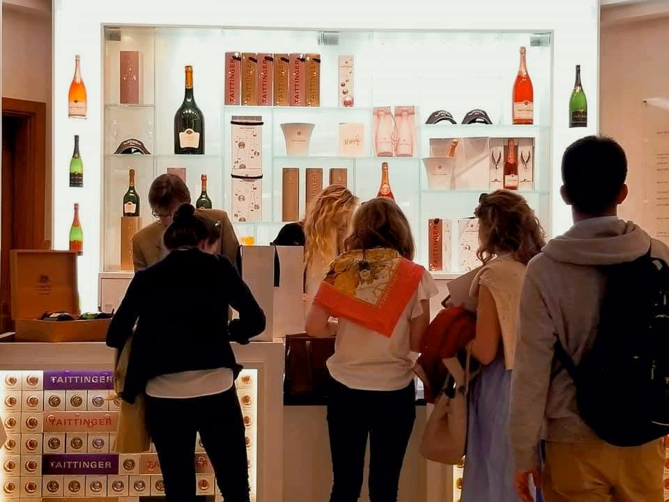 People in line to make purchases after a champagne tour in Reims at House Taittinger.