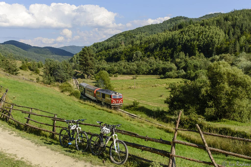 Rhodope Narrow Gauge train traveling through hills and forest in Bulgaria.
