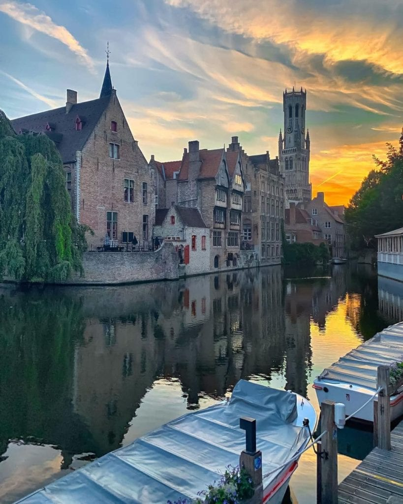 Rozenhoedkaai in Bruges, one of the most visited historic landmarks in the city, seen at sunset.