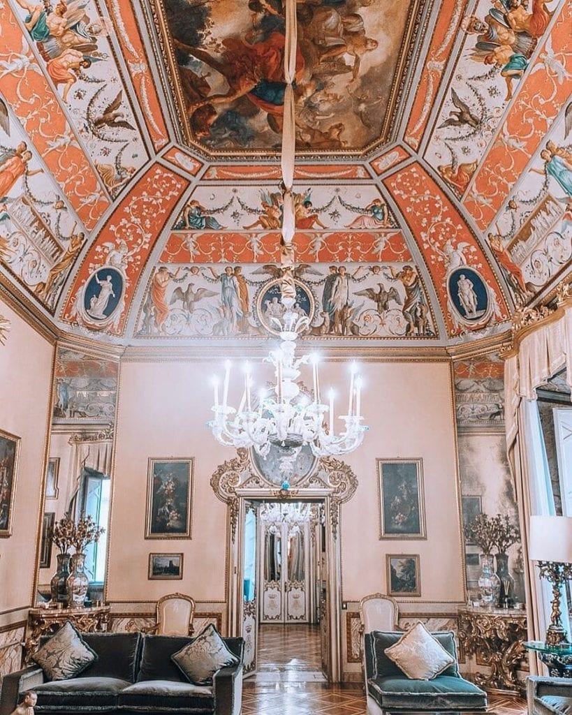Pink and blue colored lavish hotel interior that was once the residence where the young Emperor Bonaparte lived.