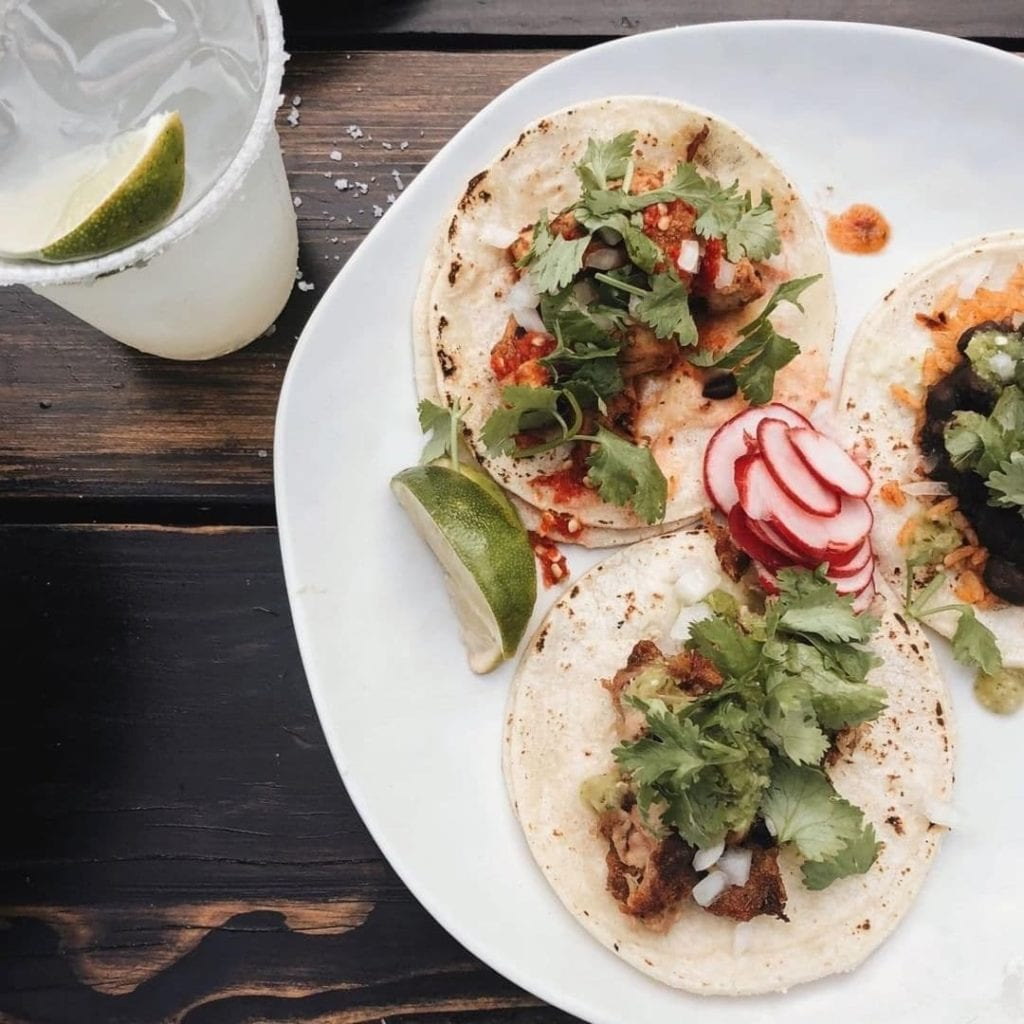 Plate of tacos with cilantro and radish garnish from Tallulah's in Providence, RI.