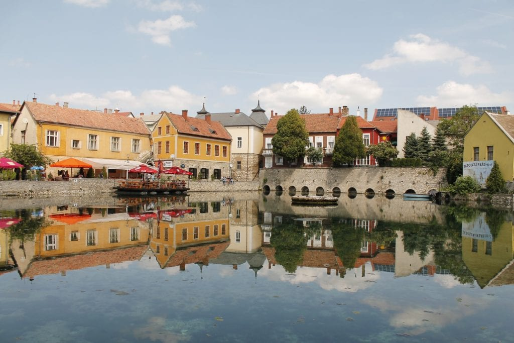 Buildings reflected on water in Tapolca, Hungary.