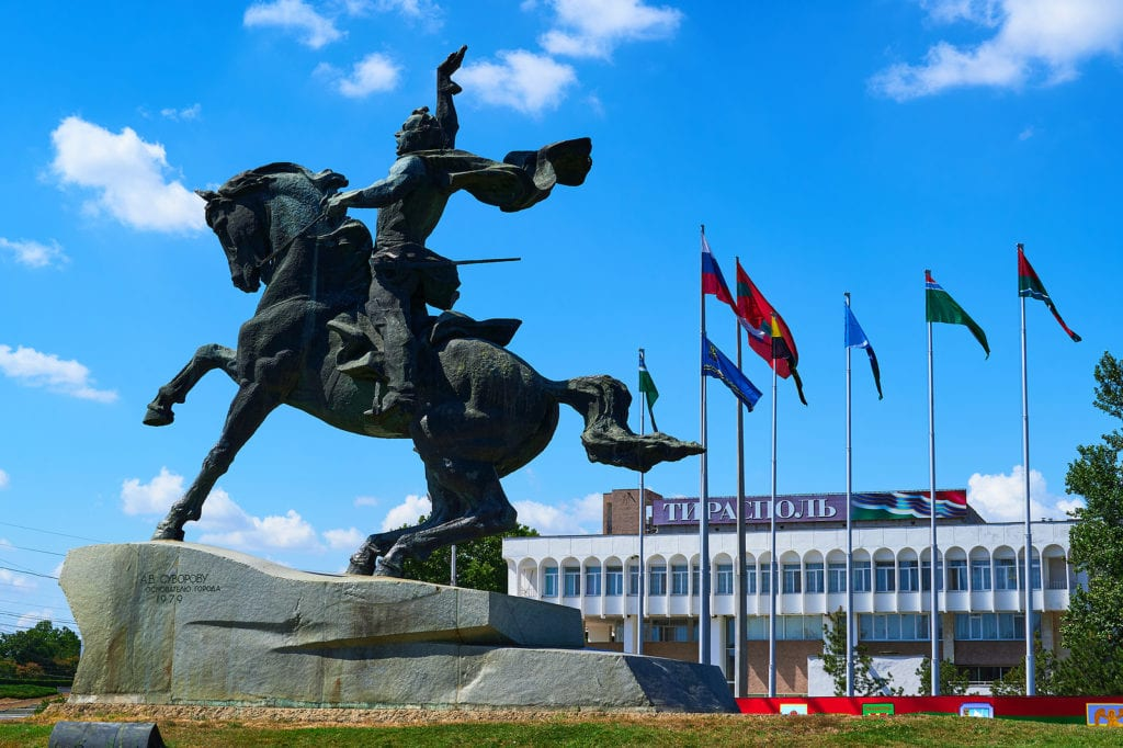 Downtown Tiraspol, Transnistria with monument and flags in the background.