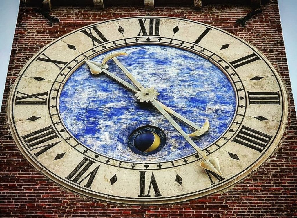 Close-up of the clock at Torre Bissara in Vicenza, Italy