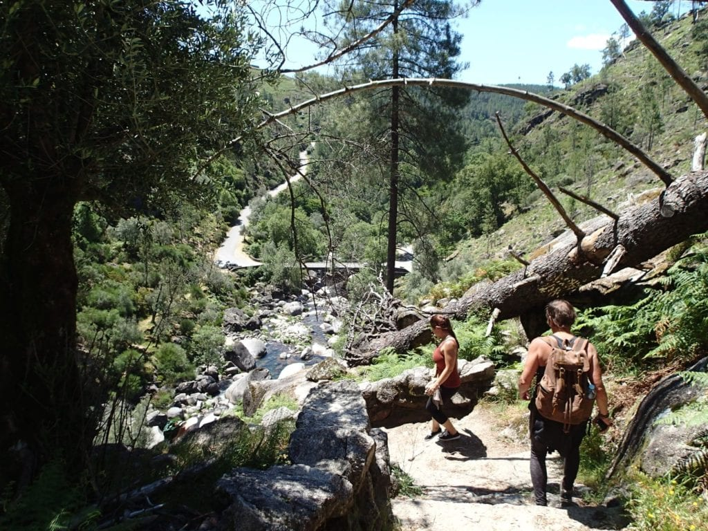 Two women hiking through the forest in Peneda-Geres National Park in Portugal