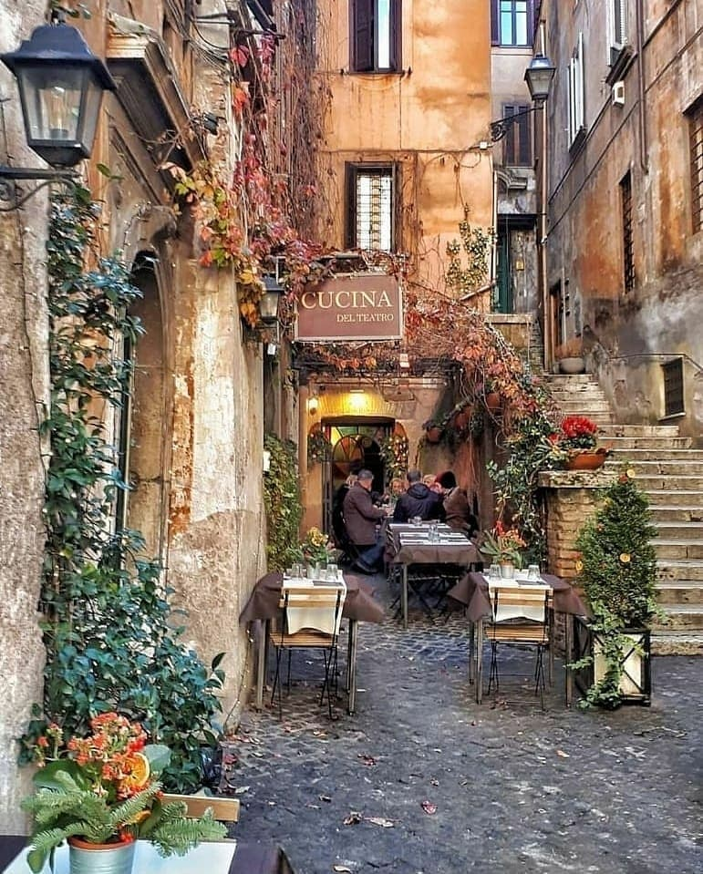 Three tables set up outside Cucina del Teatro in Trastevere, Rome on one of the most Instagrammable streets in Rome.