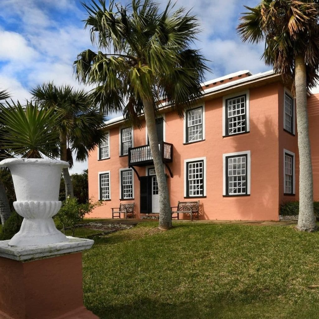 Exterior of the National Trust in Bermuda with palm trees in the front yard