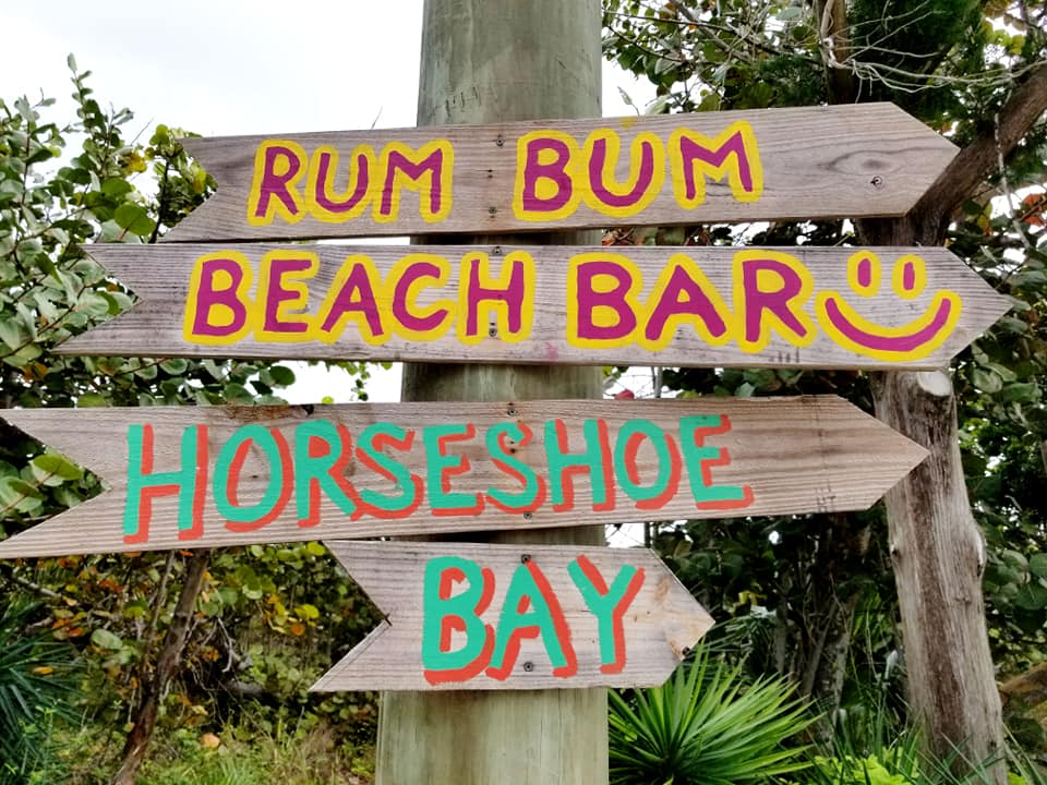 Painted wooden signs in Bermuda to beach bar and Horseshoe Bay