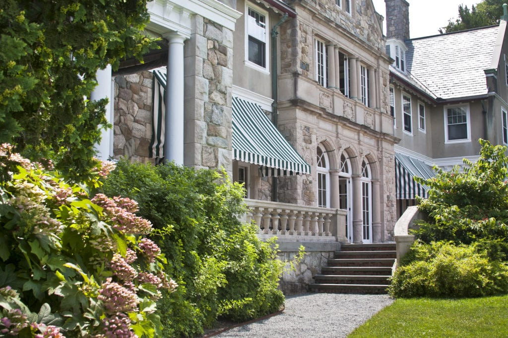Exterior façade and gardens of Blithewold Mansion in Rhode Island.