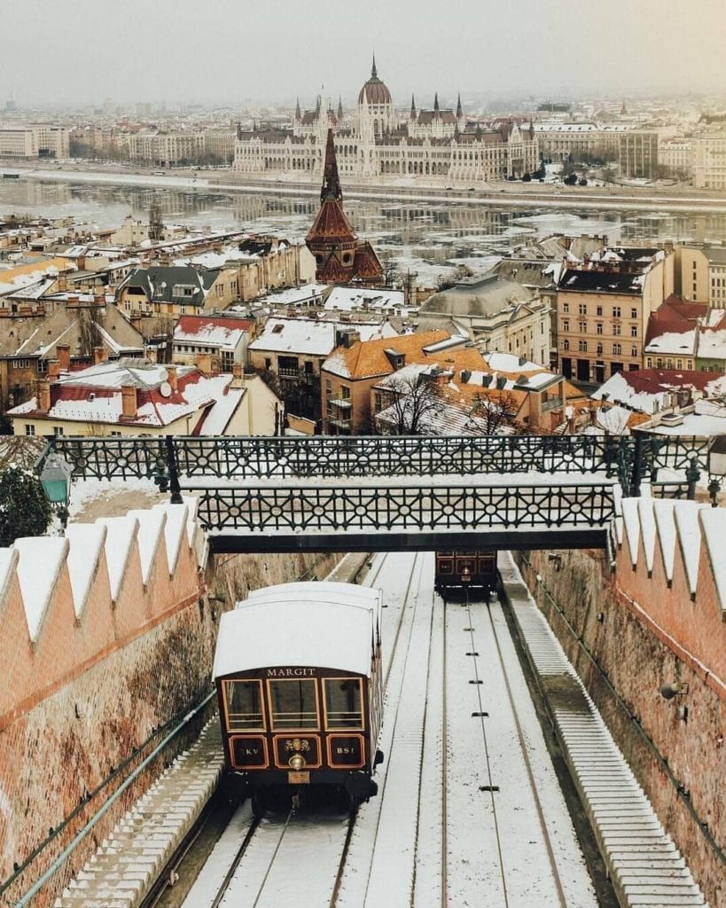Budapest funicular going down the hill with a light dusting of snow covering the lift.