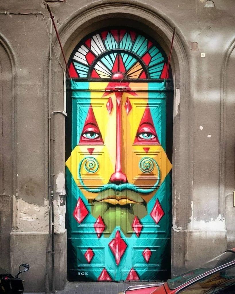 Budapest street art covering doors.