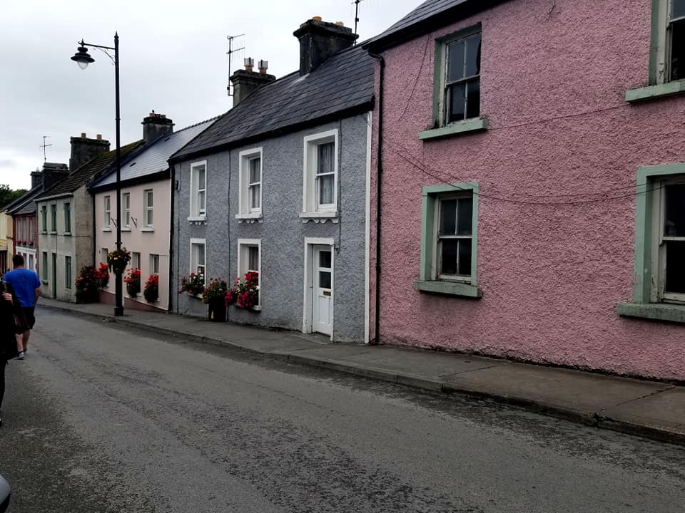 Colorful buildings lining a small street in Cong, Ireland