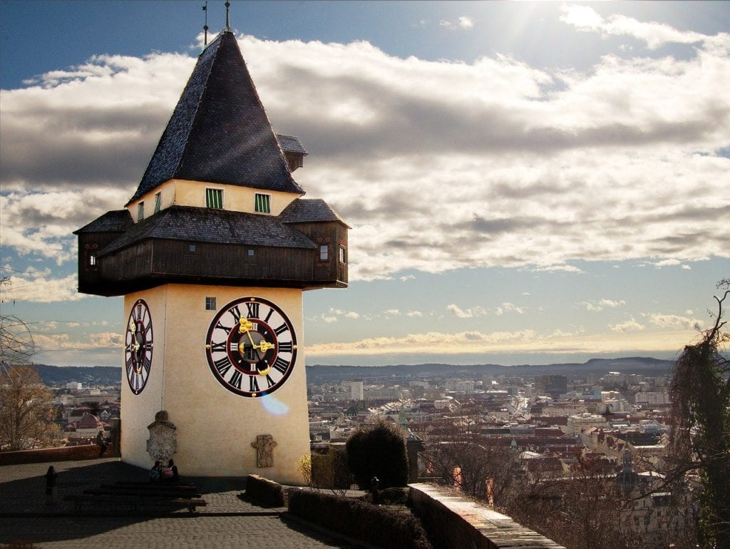 The city of Graz in the background with its prominent clocktower in the foreground.  A great day trip from Vienna, Austria.